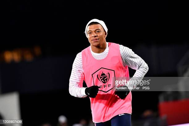 Kylian Mbappe of Paris SaintGermain looks on during warmup before the French Cup match between Dijon and Paris at Stade Gaston Gerard on February 12...