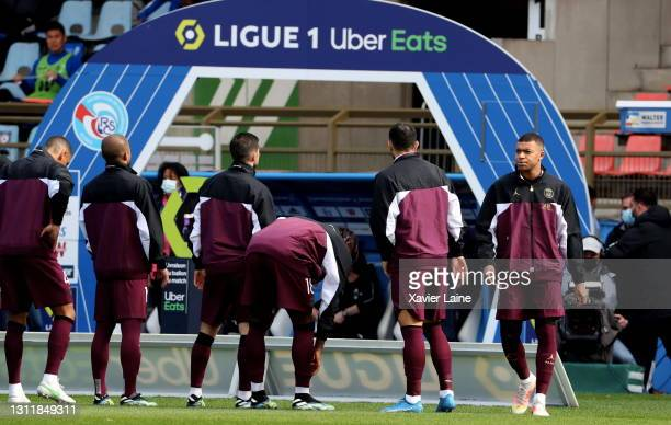Kylian Mbappe of Paris Saint-Germain poses with teammates before the Ligue 1 match between Strasbourg and Paris at Stade de la Meinau on April 10,...