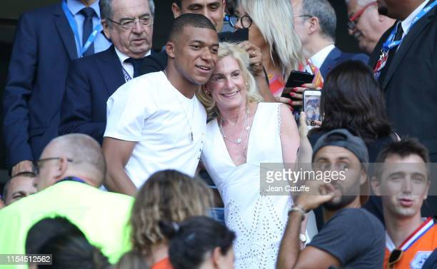 Kylian Mbappe of Paris SaintGermain poses with US Ambassador to France Jamie McCourt prior to the 2019 FIFA Women's World Cup France Final match...