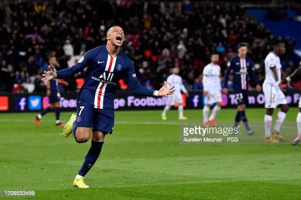 Kylian Mbappe of Paris Saint-Germain reacts after scoring during the Ligue 1 match between Paris Saint-Germain and Dijon FCO at Parc des Princes on...