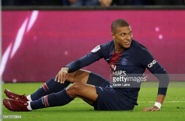 Kylian Mbappe of Paris SaintGermain reacts during the French Ligue 1 match between Paris Saint Germain and Olympique Lyon on October 07 2018 in Paris...