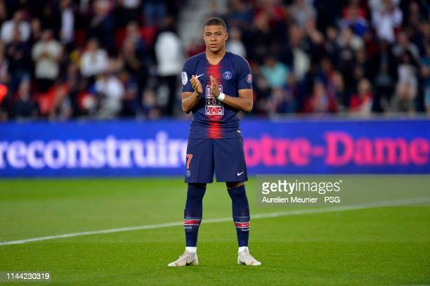 Kylian Mbappe of Paris Saint-Germain reacts during the tribute to Notre-Dame de Paris cathedral before the Ligue 1 match between Paris Saint-Germain...