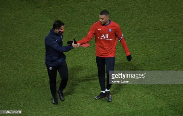 Kylian Mbappe of Paris Saint-Germain reacts with assistant coach Jesus Perez during the Ligue 1 match between Paris Saint-Germain and Montpellier HSC...