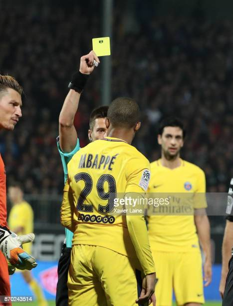 Kylian Mbappe of Paris SaintGermain receice a yellow card by the referee Benoit Bastien during the Ligue 1 match between Angers SCO and Paris Saint...