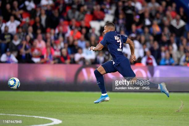 Kylian Mbappe of Paris Saint-Germain runs with the ball during the Ligue 1 match between Paris Saint-Germain and Nimes Olympique at Parc des Princes...