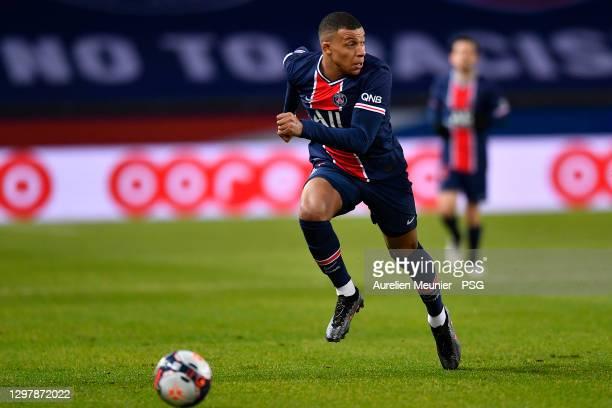 Kylian Mbappe of Paris Saint-Germain runs with the ball during the Ligue 1 match between Paris Saint-Germain and Montpellier HSC at Parc des Princes...