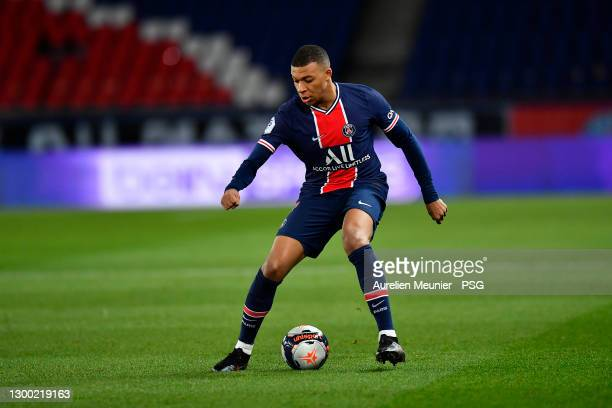 Kylian Mbappe of Paris Saint-Germain runs with the ball during the Ligue 1 soccer match between Paris Saint-Germain and Nimes Olympique at Parc des...