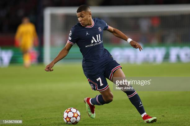 Kylian Mbappe of Paris Saint-Germain runs with the ball during the UEFA Champions League group A match between Paris Saint-Germain and Manchester...