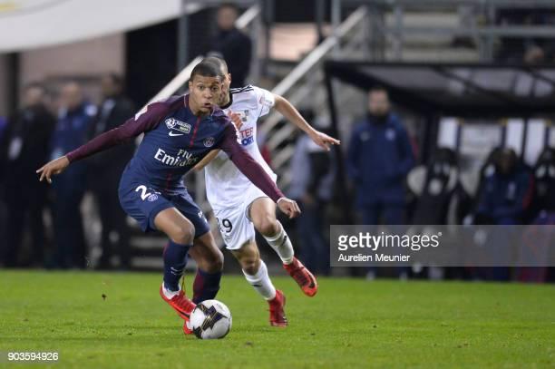 Kylian Mbappe of Paris SaintGermain runs with the ball during the League cup match between Amiens and Paris Saint Germain at Stade de la Licorne on...