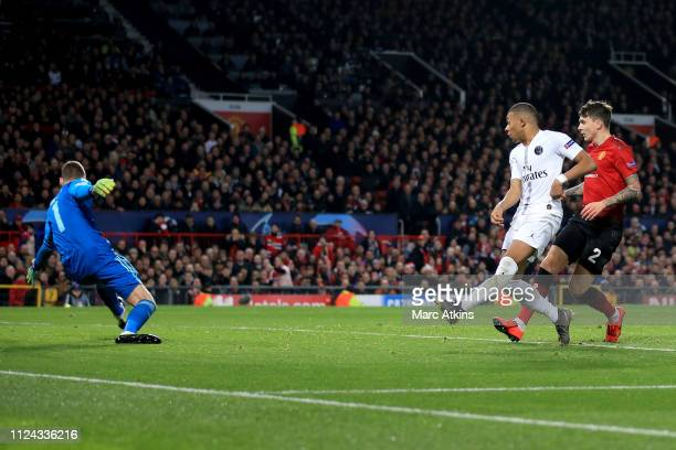 Kylian Mbappe of Paris Saint-Germain scores their 2nd goal during the UEFA Champions League Round of 16 First Leg match between Manchester United and...
