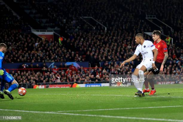 Kylian Mbappe of Paris SaintGermain scores their 2nd goal during the UEFA Champions League Round of 16 First Leg match between Manchester United and...