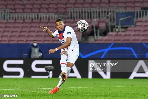 Kylian Mbappe of Paris Saint-Germain scores their side's fourth goal during the UEFA Champions League Round of 16 match between FC Barcelona and...