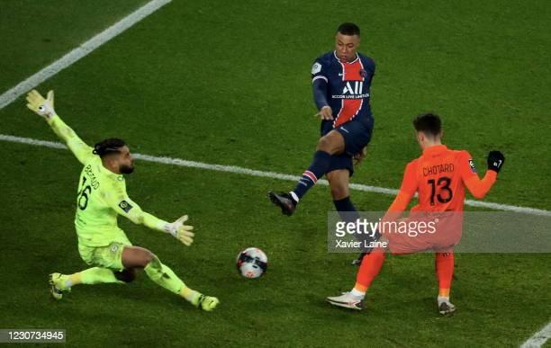 Kylian Mbappe of Paris Saint-Germain shoots the ball against Dimitry Bertaud of Montpellier HSC during the Ligue 1 match between Paris Saint-Germain...