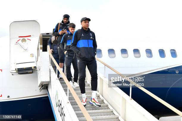 Kylian Mbappe of Paris SaintGermain walks out of the plane as the team arrive to Dijon for the French Cup match between Dijon and Paris at Stade...