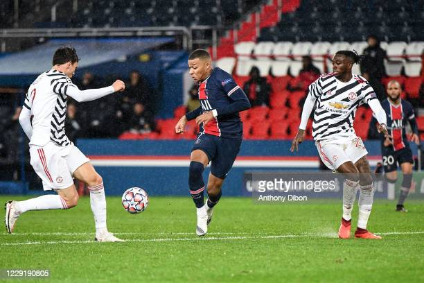 Kylian MBAPPE of PSG and Aaron WAN BISSAKA of Manchester United and Victor LINDELOF of Manchester United during the UEFA Champions League match...