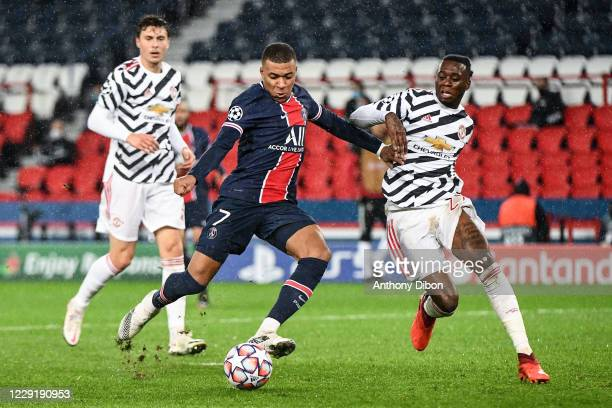 Kylian MBAPPE of PSG and Aaron WAN BISSAKA of Manchester United during the UEFA Champions League match between Paris Saint Germain and Manchester...