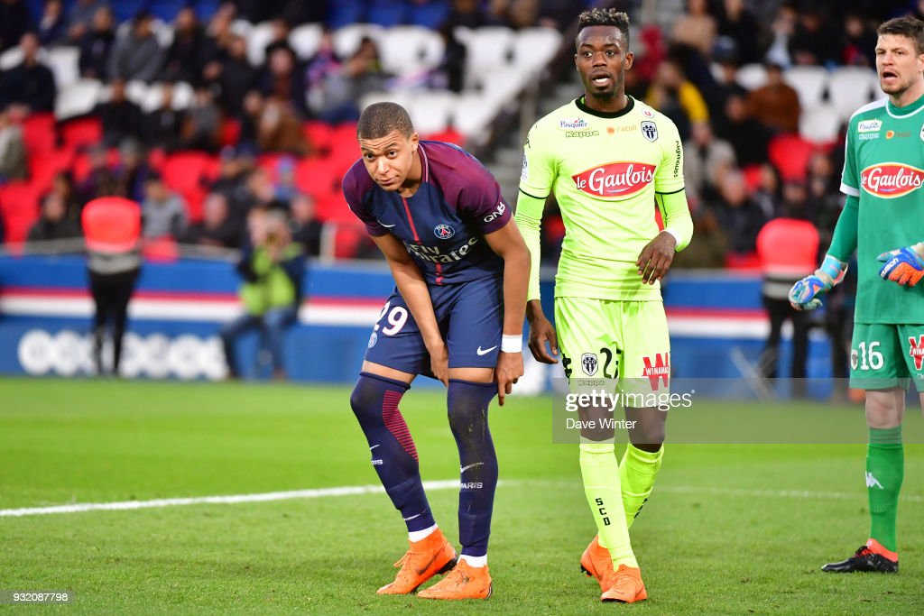 Kylian Mbappe of PSG and Abdoulaye Bamba of Angers during the Ligue 1 match between Paris Saint Germain (PSG) and Angers SCO on March 14, 2018 in Paris, France.