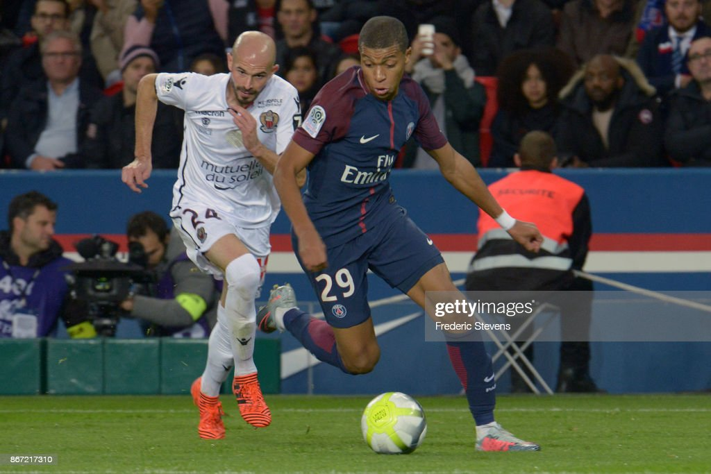Kylian Mbappe of PSG and Christophe Jallett of Nice during the Ligue 1 match between Paris Saint Germain and Nice at Parc des Princes stadium on October 27, 2017 in Paris, France.