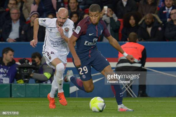 Kylian Mbappe of PSG and Christophe Jallett of Nice during the Ligue 1 match between Paris Saint Germain and Nice at Parc des Princes stadium on...