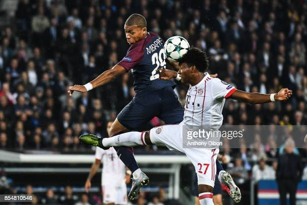 Kylian Mbappe of PSG and David Alaba of Bayern Munich during the Uefa Champions League match between Paris Saint Germain and Fc Bayern Muenchen on...