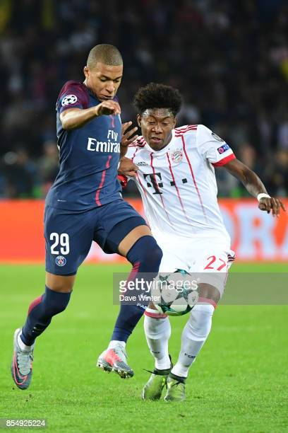 Kylian Mbappe of PSG and David Alaba of Bayern Munich during the Uefa Champions League match between Paris Saint Germain and FC Bayern Munich on...