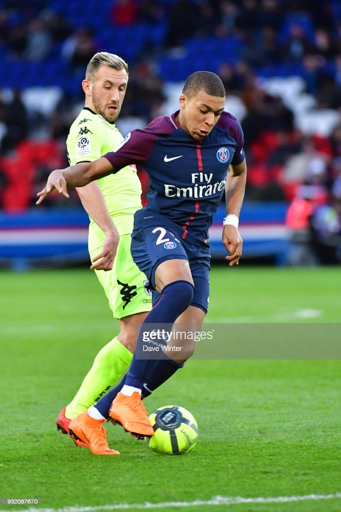 Kylian Mbappe of PSG and Flavien Tait of Angers during the Ligue 1 match between Paris Saint Germain (PSG) and Angers SCO on March 14, 2018 in Paris, France.