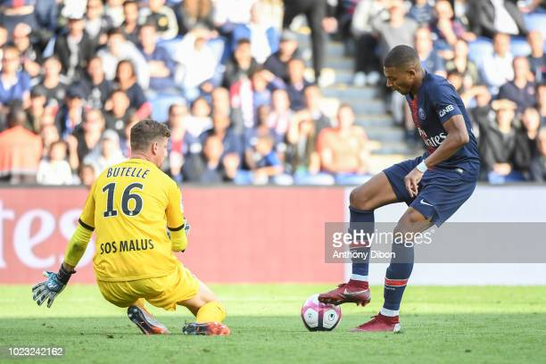 Kylian Mbappe of PSG and Ludovic Butelle of Angers during Ligue 1 match between Paris Saint Germain PSG and Angers on August 25 2018 in Paris France