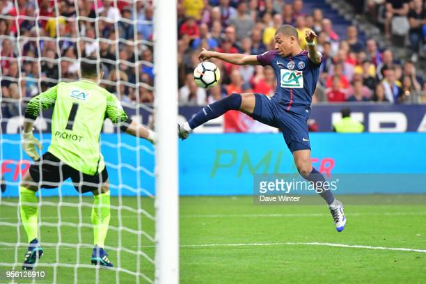 Kylian Mbappe of PSG and Matthieu Pichot of Les Herbiers during the French Cup Final between Les Herbiers and Paris Saint Germain at Stade de France...
