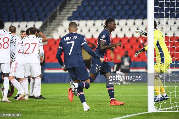 Kylian MBAPPE of PSG and Moise KEAN of PSG celebrate during the UEFA Champions League match between Paris Saint Germain and Manchester United at Parc...