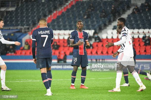 Kylian MBAPPE of PSG and Moise KEAN of PSG dejected during the UEFA Champions League match between Paris Saint Germain and Manchester United at Parc...
