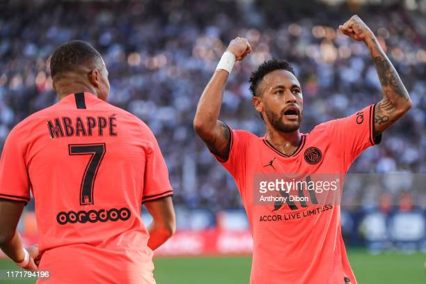 Kylian MBAPPE of PSG and NEYMAR JR of PSG celebrate a goal during the Ligue 1 match between Bordeaux and Paris Saint Germain on September 28, 2019 in...