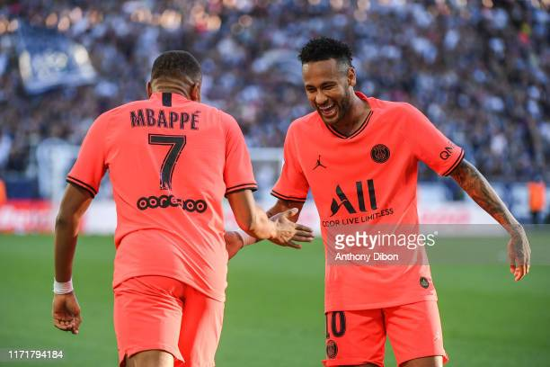 Kylian MBAPPE of PSG and NEYMAR JR of PSG celebrate during the Ligue 1 match between Bordeaux and Paris Saint Germain on September 28, 2019 in...