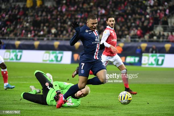 Kylian MBAPPE of PSG and Predrag RAJKOVIC of Reims during the League Cup semi-final between Stade de Reims and Paris Saint-Germain at Stade Auguste...