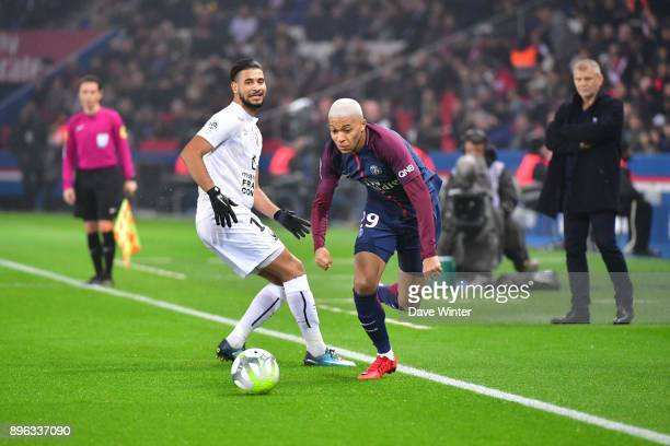 Kylian Mbappe of PSG and Youssef Ait Bennasser of Caen during the Ligue 1 match between Paris Saint Germain and SM Caen at Parc des Princes on...