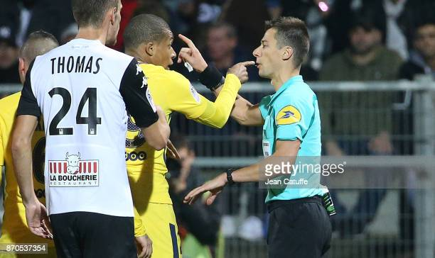 Kylian Mbappe of PSG argues with referee Benoit Bastien before receiving a yellow card during the French Ligue 1 match between Angers SCO and Paris...