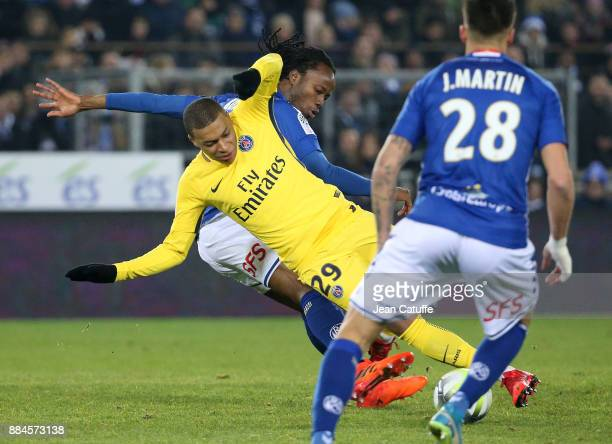 Kylian Mbappe of PSG Bakary Kone of Strasbourg during the French Ligue 1 match between RC Strasbourg Alsace and Paris Saint Germain at Stade de la...