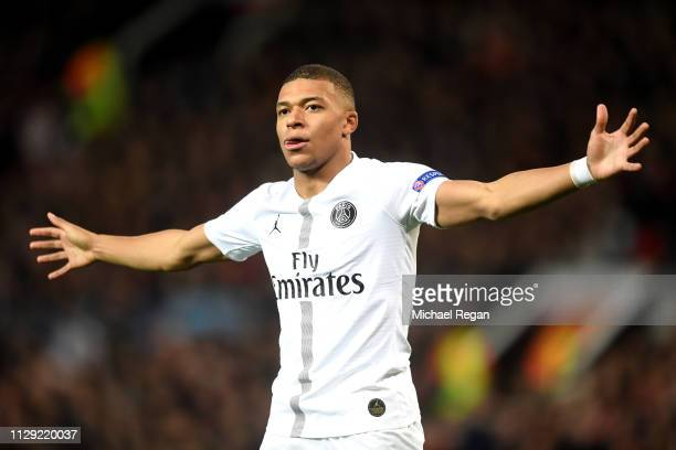 Kylian Mbappe of PSG celebrates after scoring his sides second goal during the UEFA Champions League Round of 16 First Leg match between Manchester...