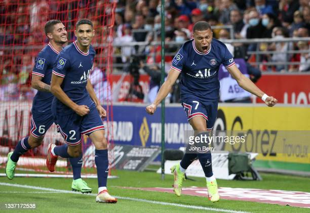 Kylian Mbappe of PSG celebrates his first goal with Achraf Hakimi, Marco Verratti during the Ligue 1 Uber Eats match between Stade Reims and Paris...