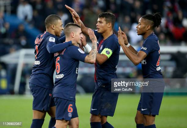 Kylian Mbappe of PSG celebrates his first goal with Marco Verratti Thiago Silva Christopher Nkunku during the French Ligue 1 match between Paris...