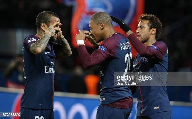 Kylian Mbappe of PSG celebrates his goal between Dani Alves aka Daniel Alves and Neymar Jr during the UEFA Champions League group B match between...