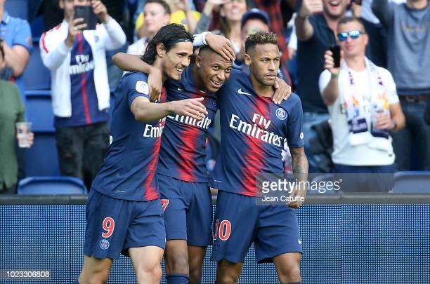 Kylian Mbappe of PSG celebrates his goal between Edinson Cavani and Neymar Jr during the french Ligue 1 match between Paris SaintGermain and SCO...