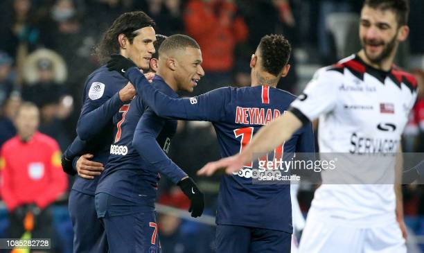 Kylian Mbappe of PSG celebrates his goal between Edinson Cavani and Neymar Jr during the french Ligue 1 match between Paris Saint Germain and En...