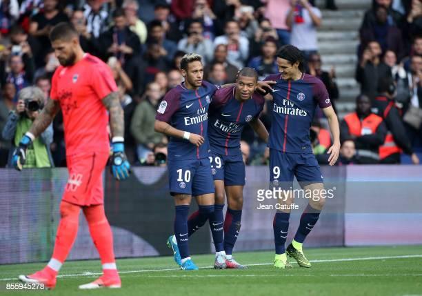 Kylian Mbappe of PSG celebrates his goal between Neymar Jr and Edinson Cavani while goalkeeper of Girondins de Bordeaux Benoit Costil looks down...