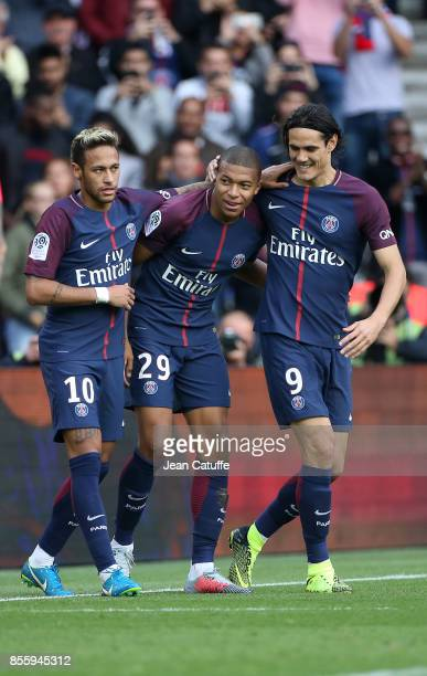 Kylian Mbappe of PSG celebrates his goal between Neymar Jr and Edinson Cavani during the French Ligue 1 match between Paris SaintGermain and FC...