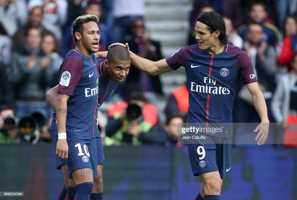 Kylian Mbappe of PSG celebrates his goal between Neymar Jr and Edinson Cavani during the French Ligue 1 match between Paris Saint-Germain (PSG) and FC Girondins de Bordeaux at Parc des Princes on September 30, 2017 in Paris, France.