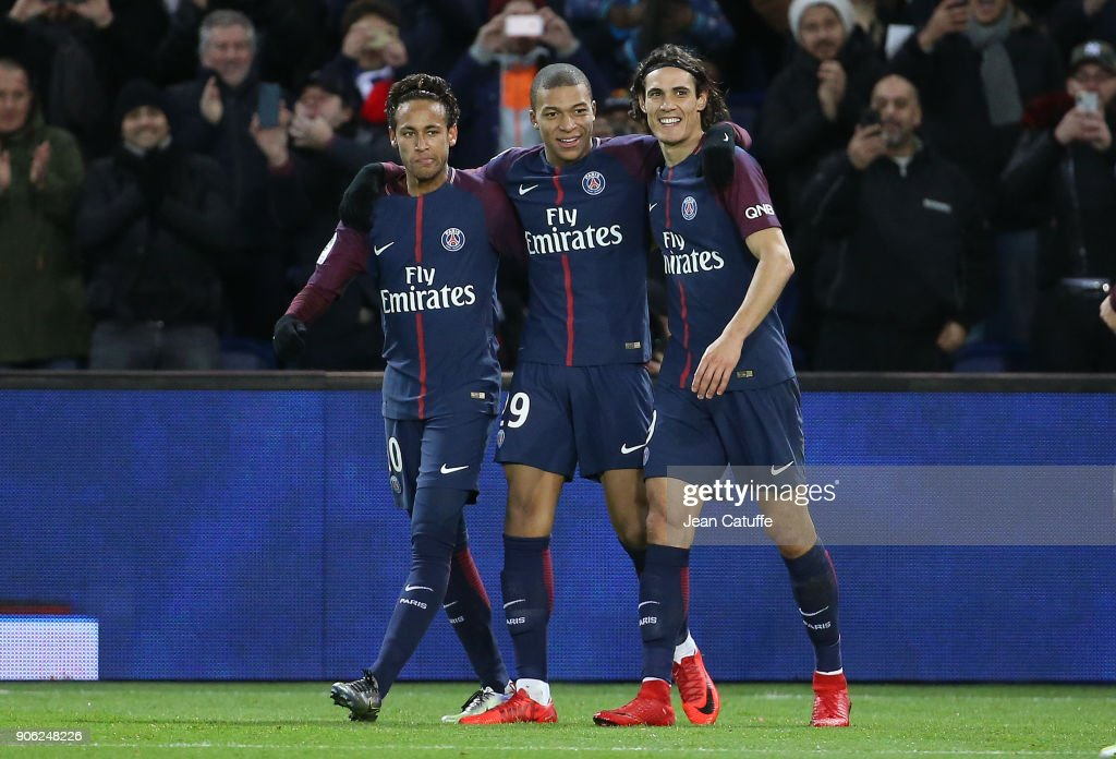 Kylian Mbappe of PSG celebrates his goal between Neymar Jr and Edinson Cavani during the French Ligue 1 match between Paris Saint Germain (PSG) and Dijon FCO at Parc des Princes stadium on January 17, 2018 in Paris, France.