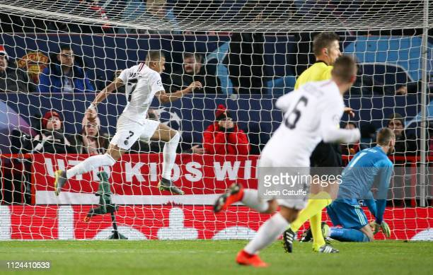 Kylian Mbappe of PSG celebrates his goal while goalkeeper of Manchester United David de Gea lies down during the UEFA Champions League Round of 16...