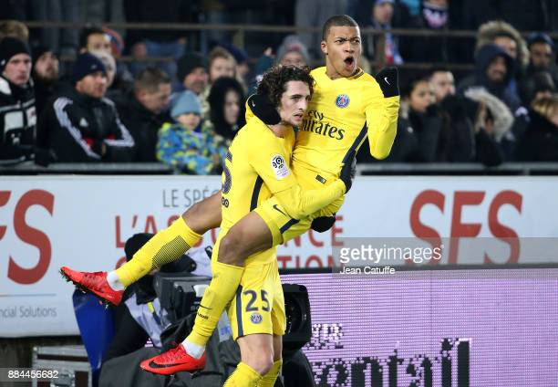 Kylian Mbappe of PSG celebrates his goal with Adrien Rabiot during the French Ligue 1 match between RC Strasbourg Alsace and Paris Saint Germain at...