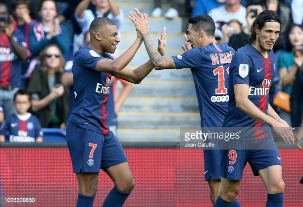 Kylian Mbappe of PSG celebrates his goal with Angel Di Maria during the french Ligue 1 match between Paris SaintGermain and SCO Angers at Parc des...