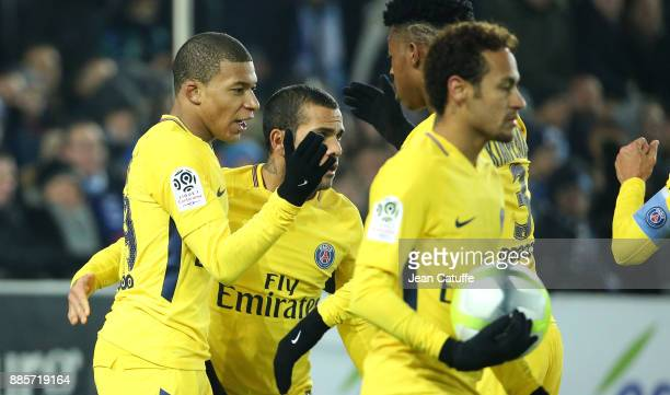 Kylian Mbappe of PSG celebrates his goal with Dani Alves Presnel Kimpembe Neymar Jr during the French Ligue 1 match between RC Strasbourg Alsace and...
